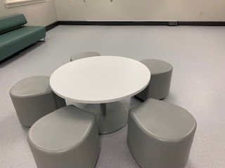 Photo of tables, chairs, and couch