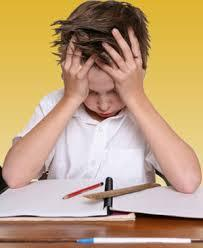 picture of boy struggling with schoolwork.